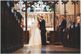 bride and groom kiss at great waltham church