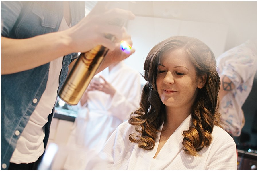 bride having her hair done before her wedding at Crondon Park