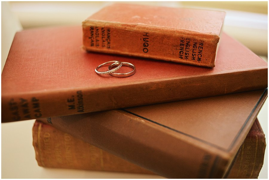 wedding rings on some books