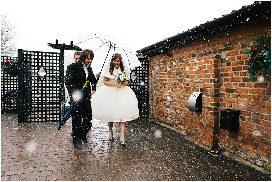 bride arriving at Crondon Park in the snow