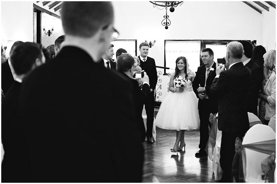Bride walking down the aisle at crondon park