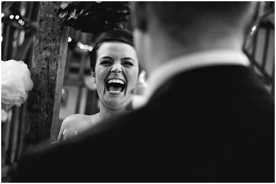 bridesmaid laughing at a wedding at crondon park