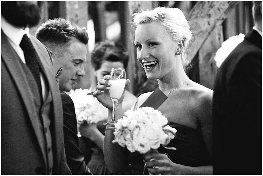bridesmaid drinking champagne at a wedding at Crondon Park