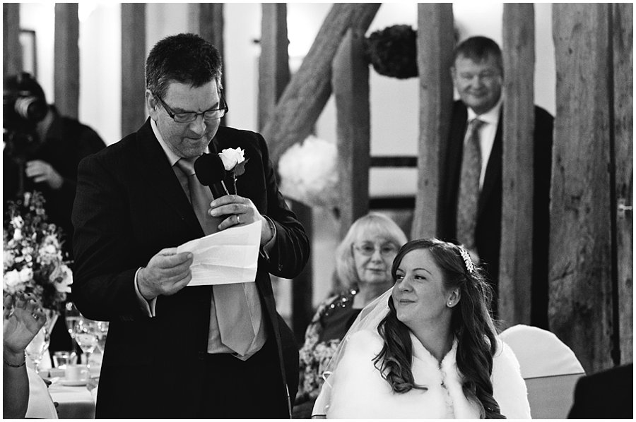 bride looks lovingly at her father during his speech at their Crondon Park wedding