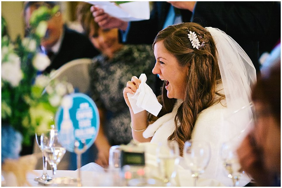 bride laughing during her groom's speech at Crondon Park