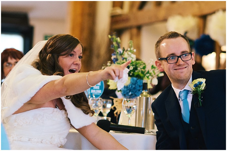 bride points and screen, laughing