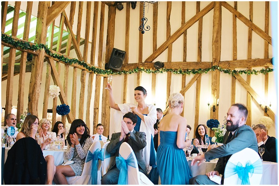 wedding guests toasting the speeches at crondon park