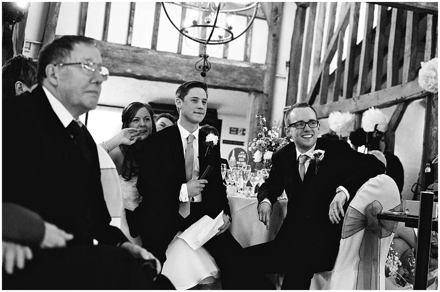 bride, groom and best man watch slideshow as part of best man's speech at Crondon Park