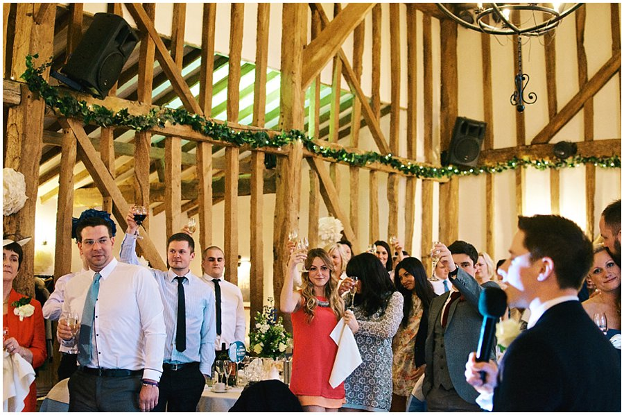 wedding guests toasting the bride and groom at their wedding at Crondon Park