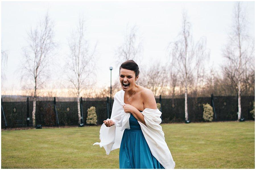 bridesmaid laughing outside Crondon Park