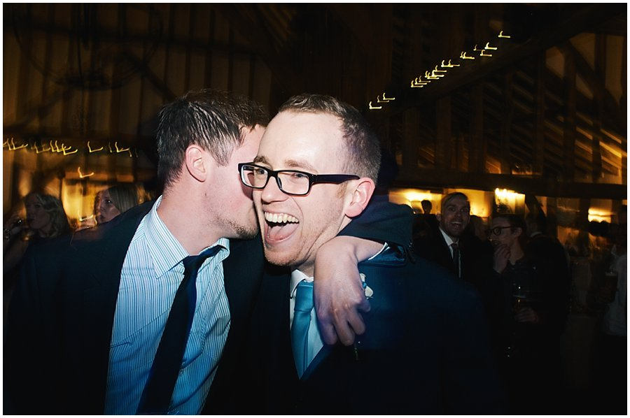 groom and guest laughing and dancing at crondon park wedding