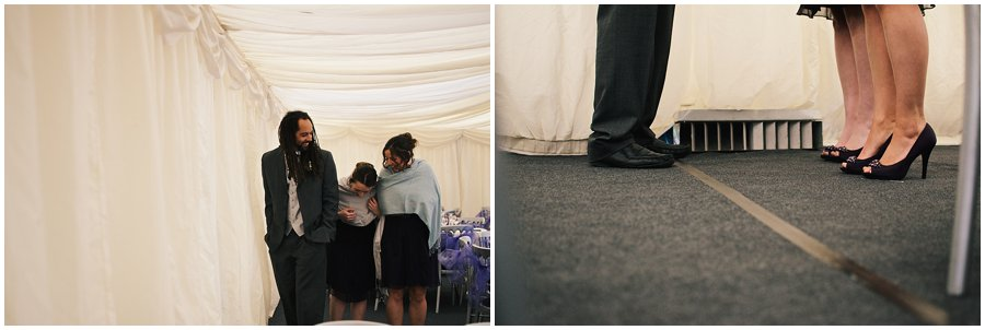 best man and bridesmaid warming up next to a heater in a marquee at red brick barn