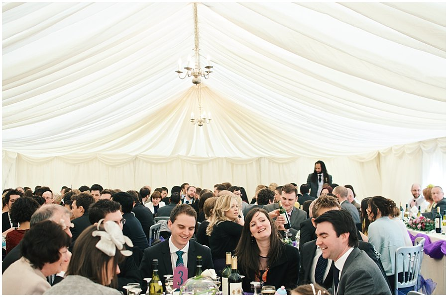 wedding guests in marquee at red brick barn