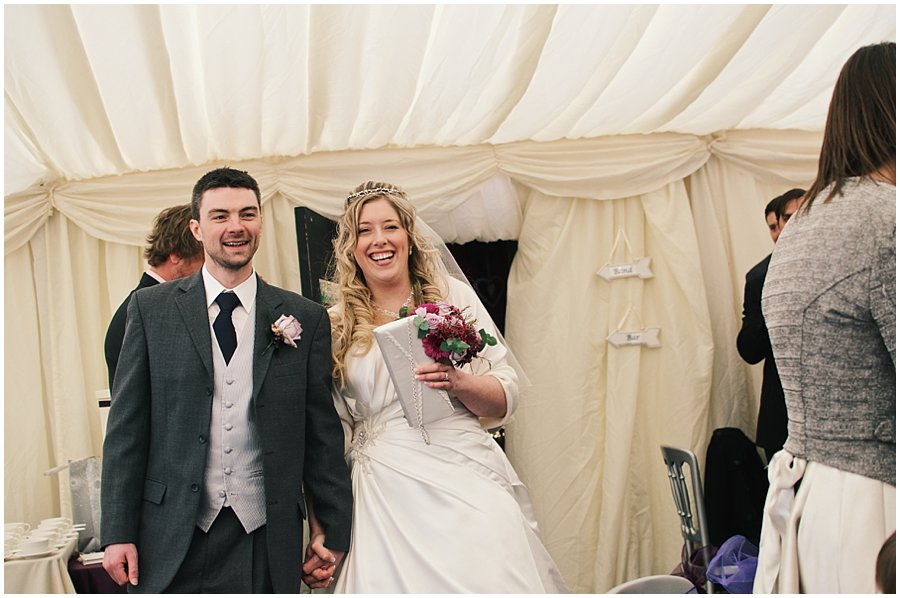 breide and groom enter the marquee at red brick barn