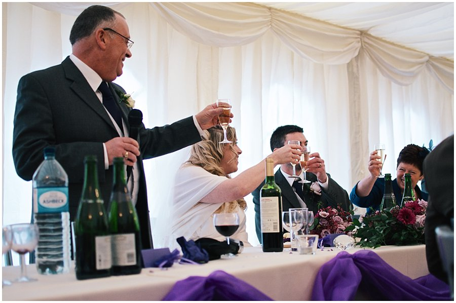 top table toasting during wedding speeches