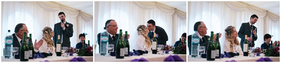 groom kissing his bride during his speech
