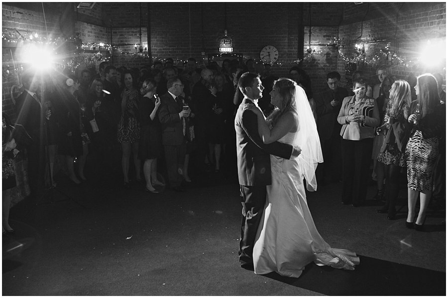 bride and groom having their first dance at red brick barn near rochford