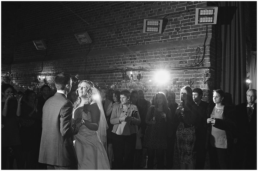 bride and groom having their first dance at red brick barn, rochford
