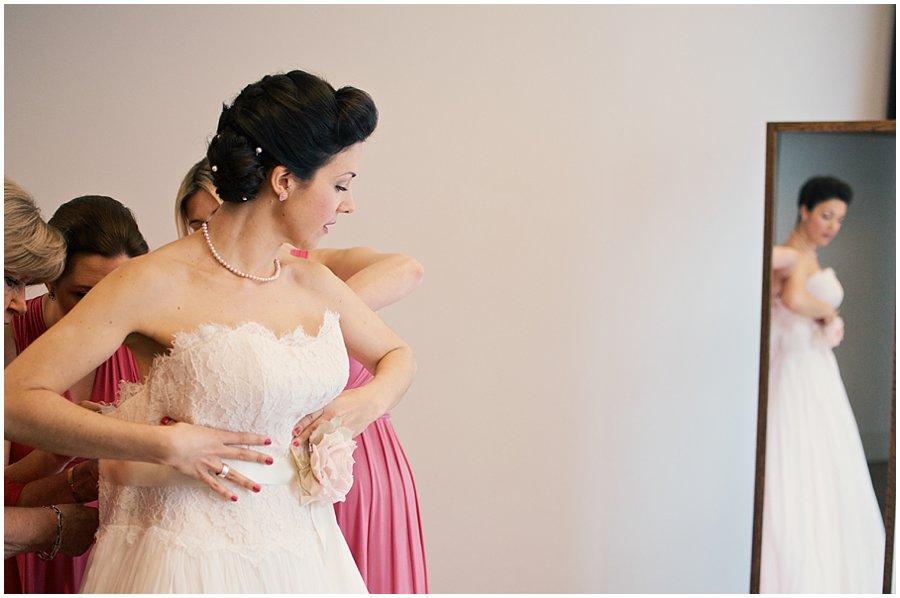 Londopn Bride putting her dress on