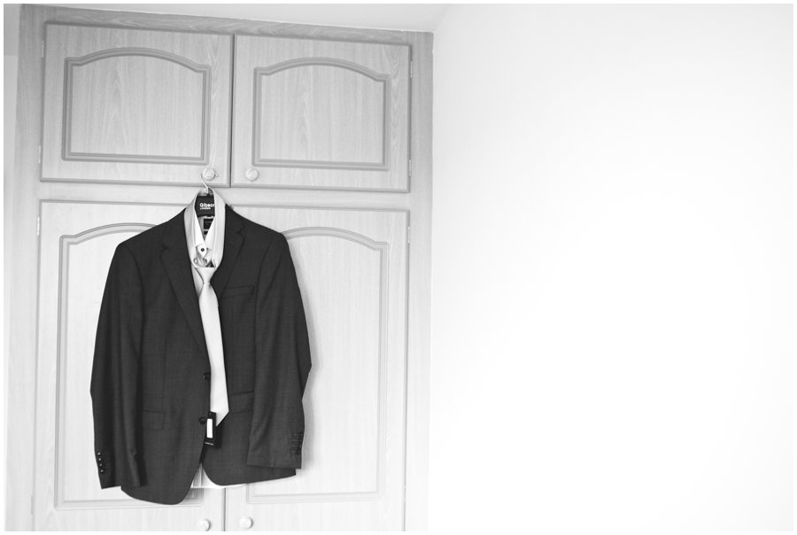groom's suit hanging on wardrobe