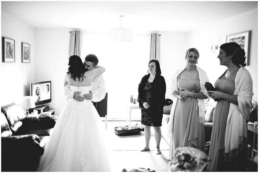 bride hugs her dad before wedding at hyde barn