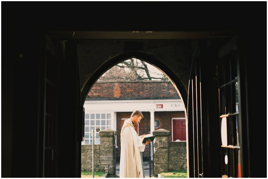 vicar waiting for bride at leigh-on-sea wedding