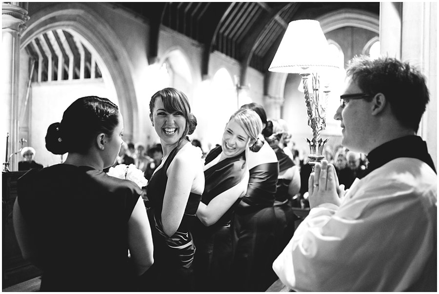 Bridesmaids laughing at East Hanningfield Church Wedding