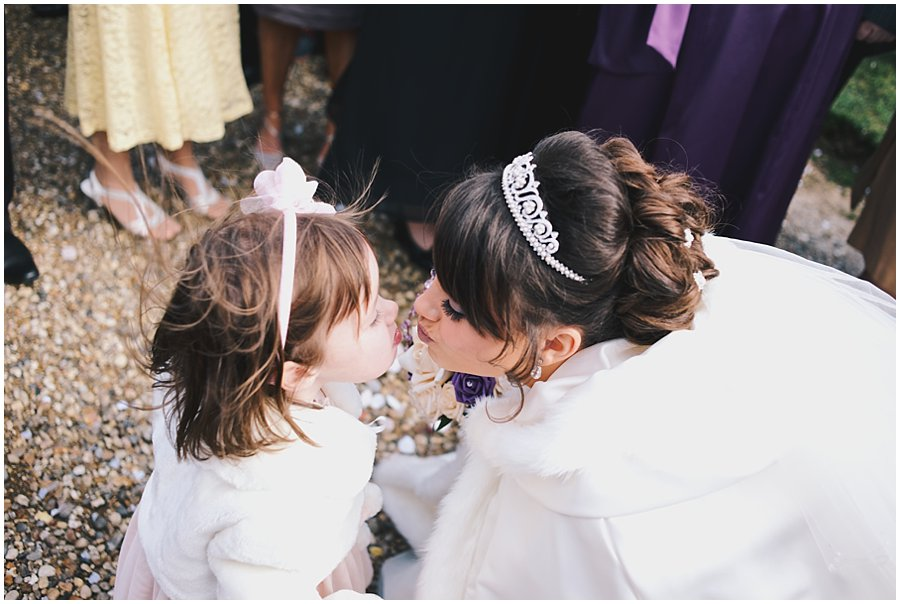 Bride kissing flower girl at East Hanningfield Church Wedding