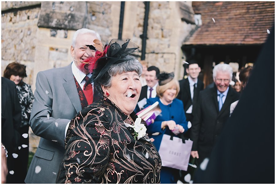 Gran throwing confetti at Essex Wedding