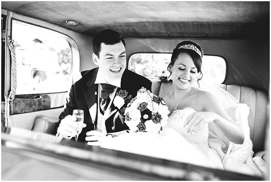 Bride and Groom in Wedding Rolls Royce
