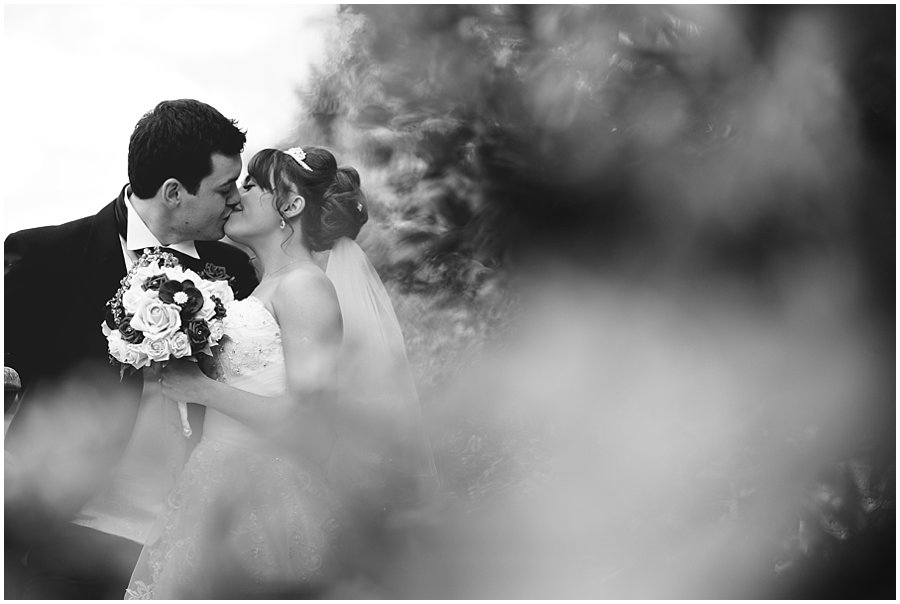 Bride and groom kissing at Newland Hall