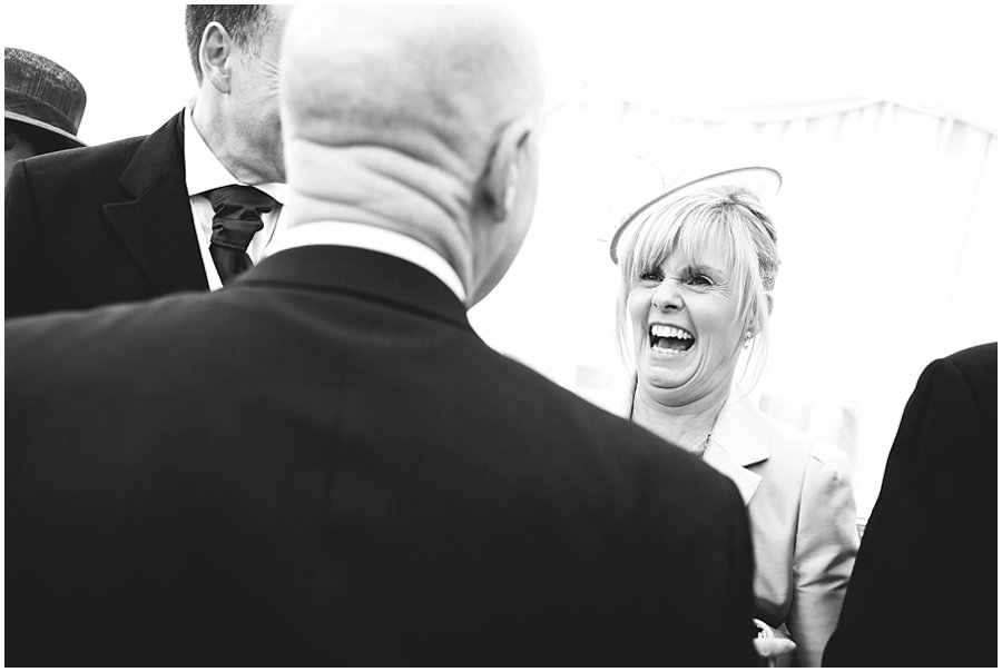 Mother of the bride laughing at Newland Hall