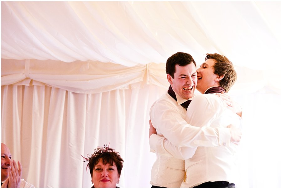 groom hugs best man after speech at Newland Hall