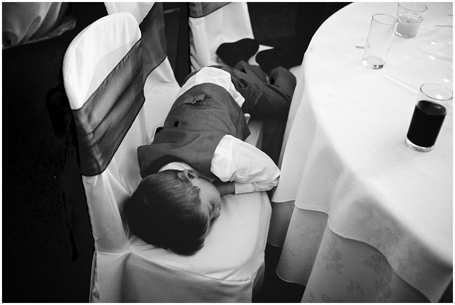 boy sleeping at wedding