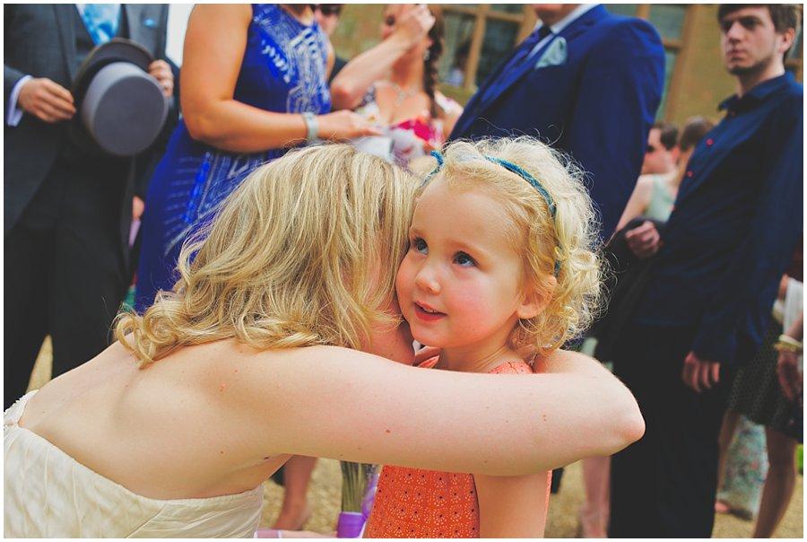 little girl giving bride a princess card