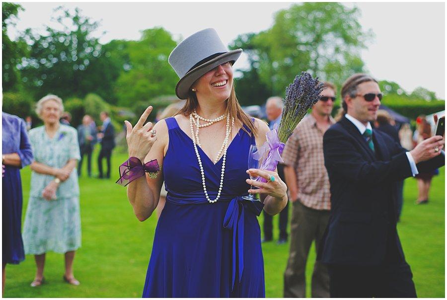 bridesmaid wearing top hat at wedding