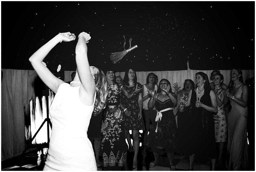 bouquet toss at Stoneleigh Abbey Wedding