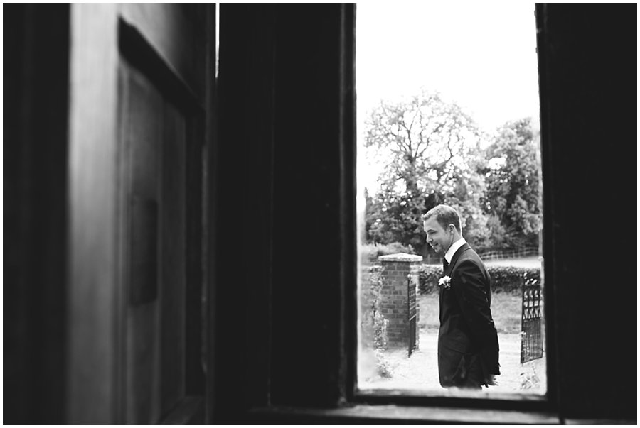 Groom waits nervously for wedding at Chappel Church, Essex