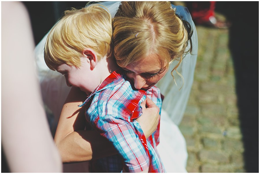 bride hugging small boy
