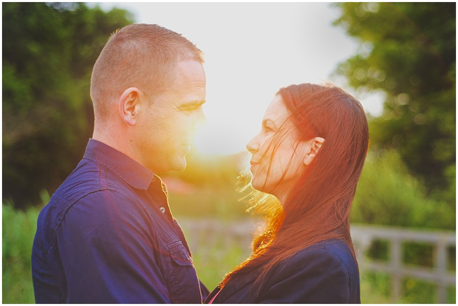 sunset light behind couple on their engagement shoot at shoebury garrison