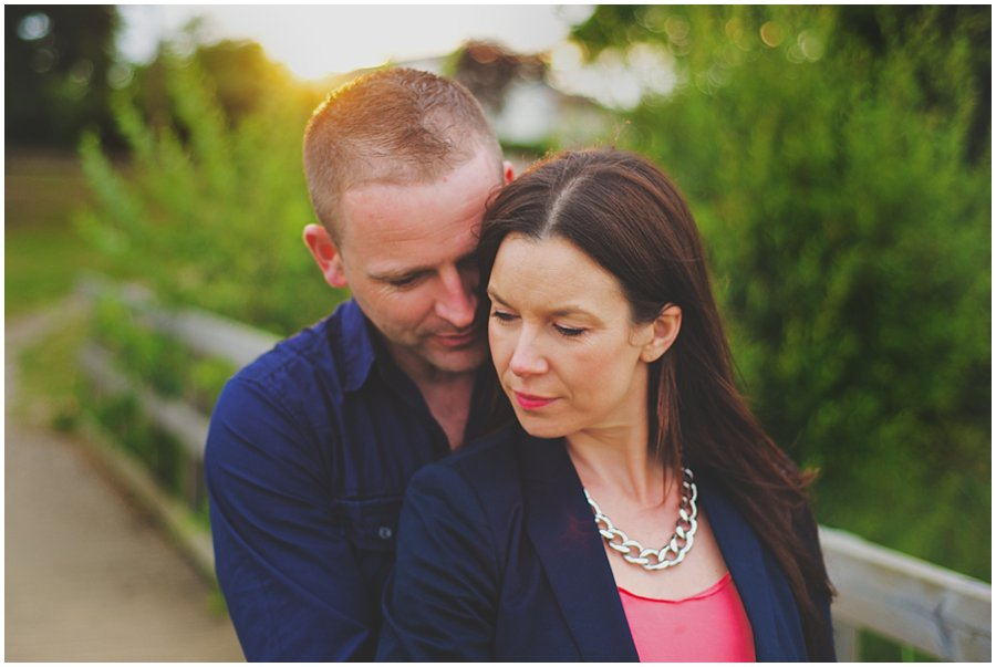 couple cuddling on their engagement shoot at shoebury garrison
