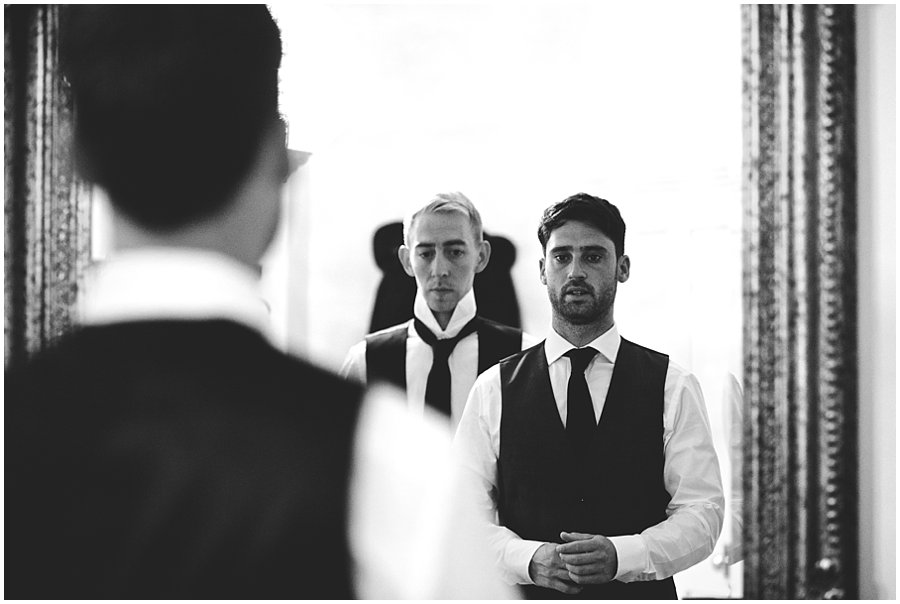 Groom and his best man getting ready at Woodhall Manor