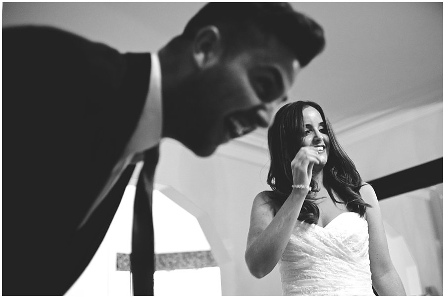 Bride and her brother laughing at Woodhall Manor wedding