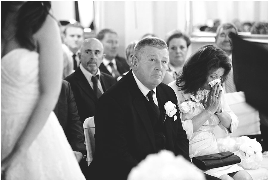 Emotional mother of the bride at Woodhall Manor wedding