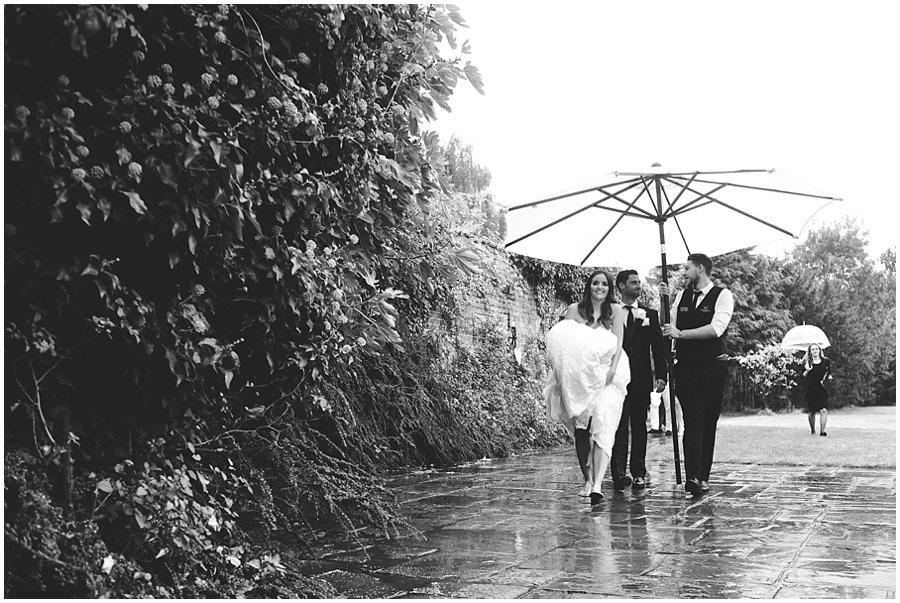 Wet wedding at Woodhall Manor