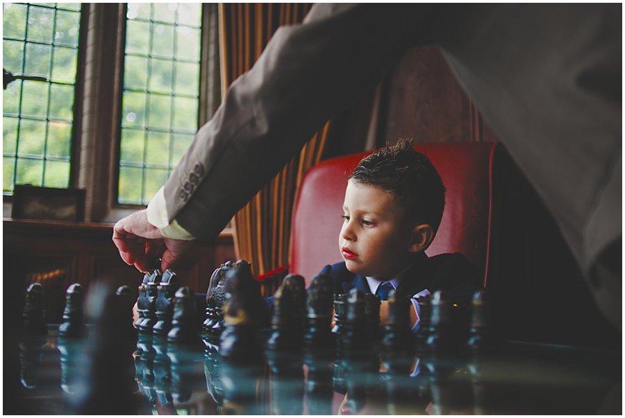 Boy playing chess at Woodhall Manor