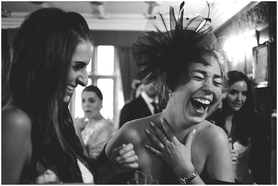 guests laughing at Woodhall Manor wedding