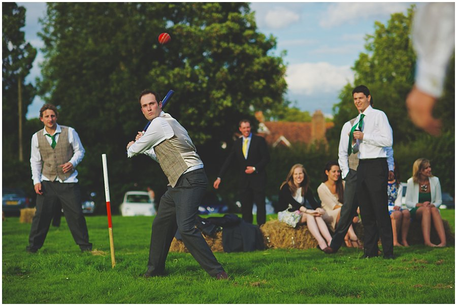 Groom playing rounders