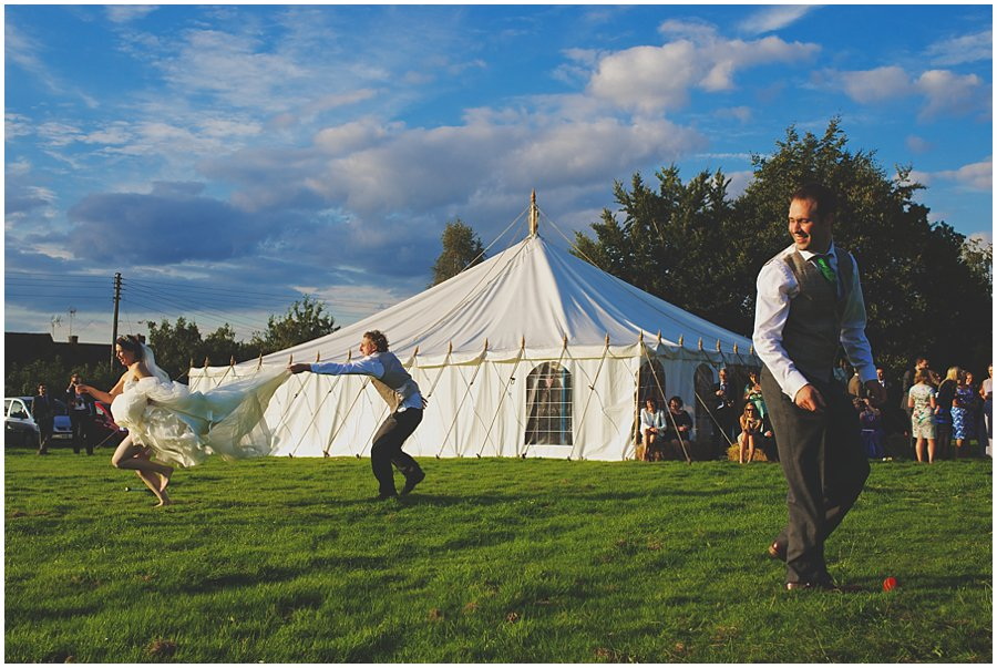 Bride and Groom playing rounders at Kingston Barn