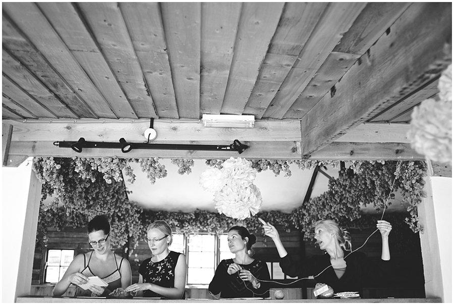 Bridesmaids hanging photos for wedding